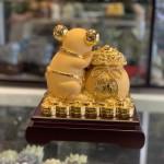 Chuột vàng ôm túi vàng TM011