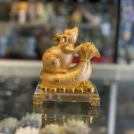 Chuột vàng trên túi vàng đế thuỷ tinh TM023
